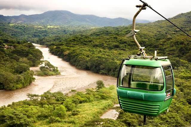 a-cable-cart-above-a-forest-and-river
