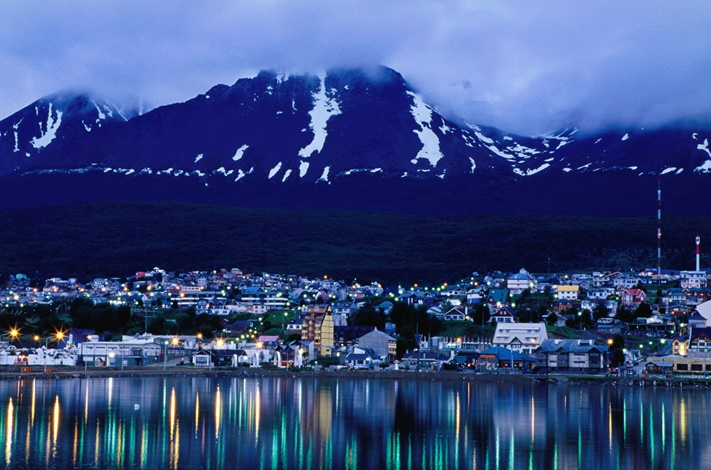 city-city-lights-reflected-in-harbour-at-dawn