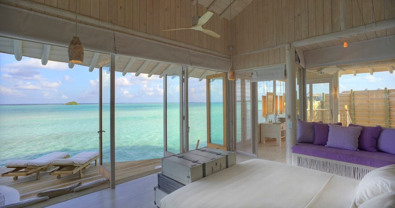 soneva-jani-1-bedroom-water-retreat-with-slide_bedroom-with-view-interior-by-stevie-mann